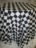 Where to rent 120  RND BLACK WHITE CHECK RACING LINEN in Lake Charles LA